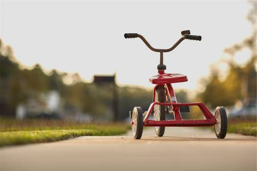 red tricycle  Free Photo