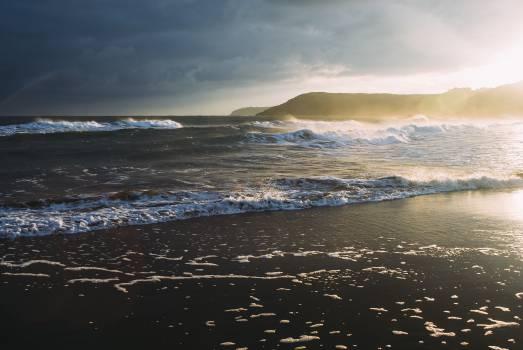 sunset beach ocean  Free Photo