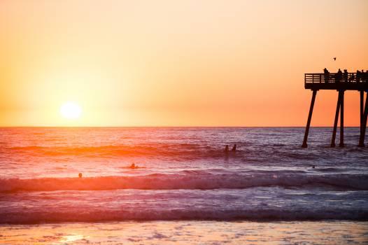 sunset beach water  Free Photo