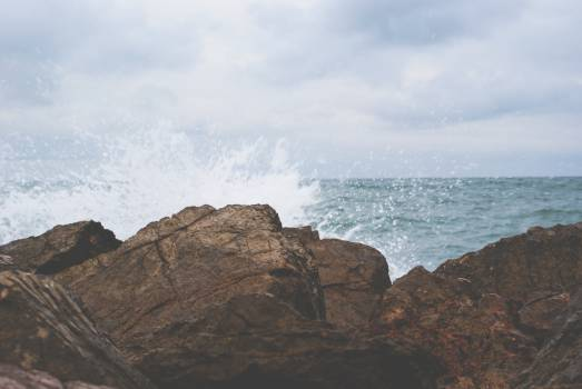 rocks boulders waves  Free Photo