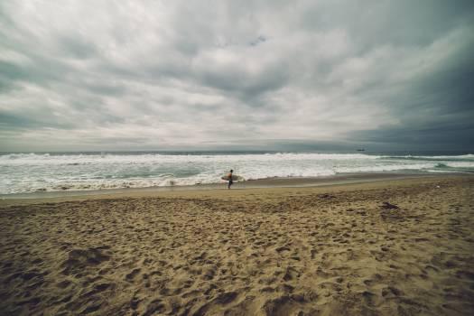 beach sand ocean  Free Photo