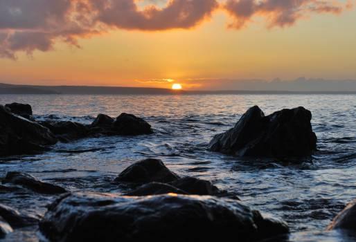 sunset dusk ocean  Free Photo