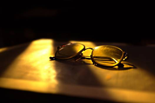 eyeglasses sunlight shadows  Free Photo