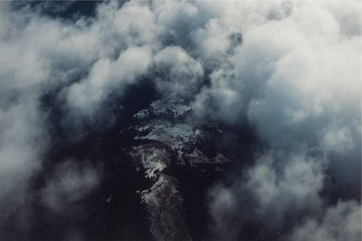 above the clouds aerial view  Free Photo