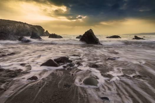 beach sand water  Free Photo