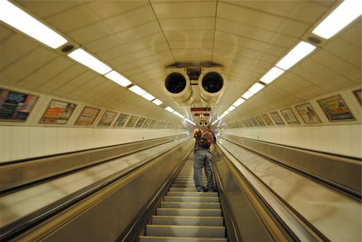 escalator subway station guy  Free Photo