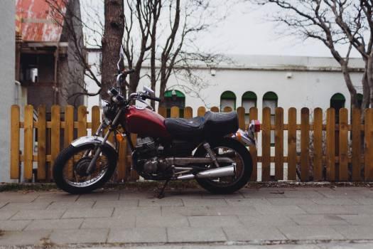 motorcycle motorbike picket fence  Free Photo