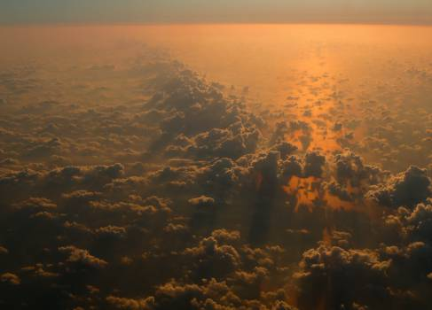 sunset above the clouds sky  Free Photo
