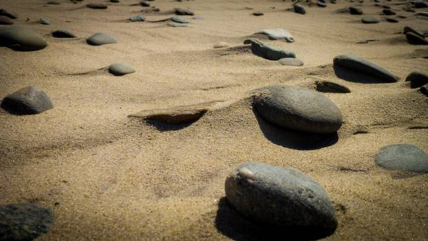 beach sand rocks  Free Photo