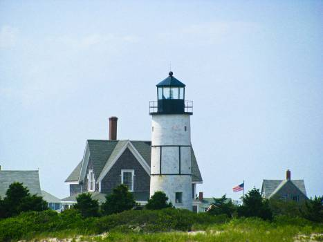 lighthouse houses flag  Free Photo