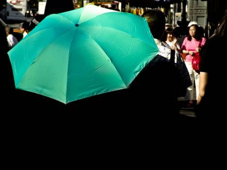 green umbrella crowd  Free Photo