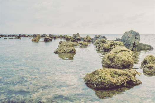 rocks boulders ocean  Free Photo