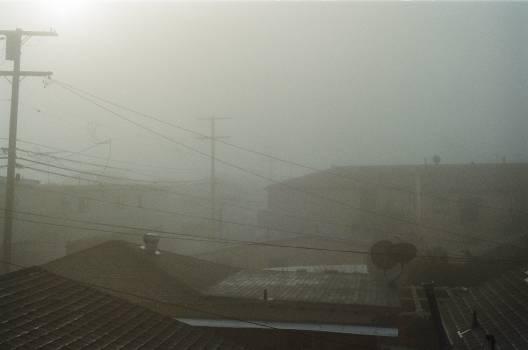 fog sky rooftops  Free Photo