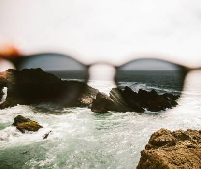 sunglasses beach ocean Free Photo