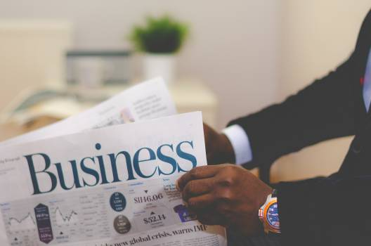 business newspaper reading #24557