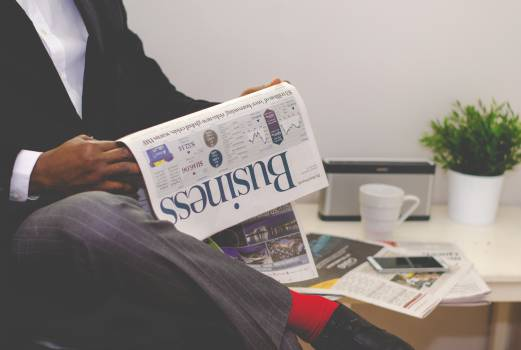 business newspaper reading #24558