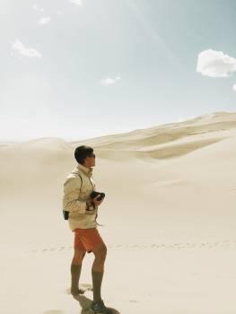 guy man sand Free Photo