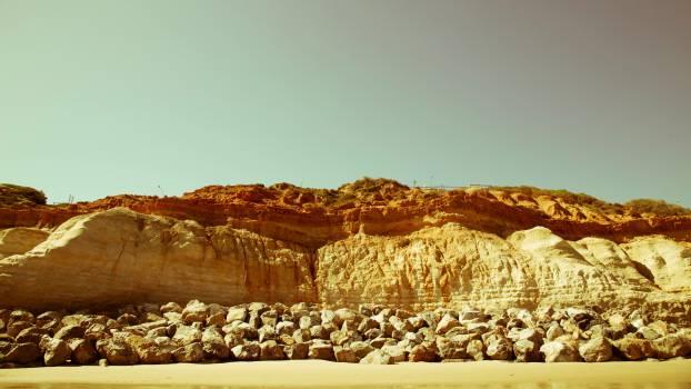 beach sand rocks Free Photo