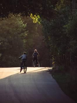 Kids cycling Free Photo