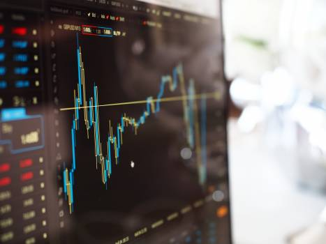 Blue and Yellow Graph on Stock Market Monitor Free Photo