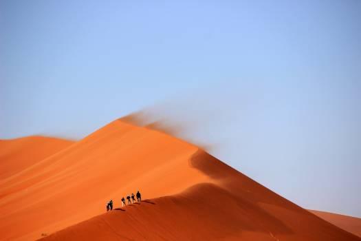 Sunny sand desert hiking Free Photo