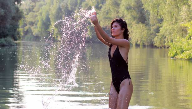 Woman Wearing Black Monokini Playing With Water #32287