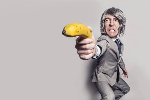 Man in Gray Suit Jacket Holding Yellow Banana Fruit While Making Face #32400