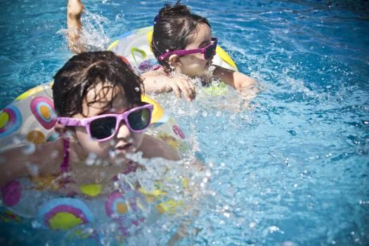 2 Girl's Swimming during Daytime Free Photo