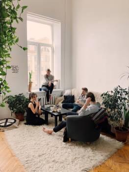 People Gathered Inside House Sitting on Sofa Free Photo