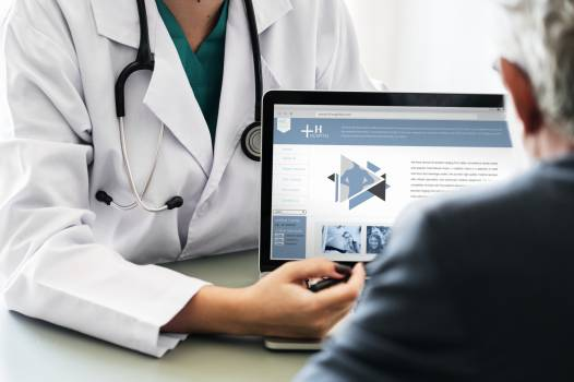 Doctor Pointing at Tablet Laptop Free Photo
