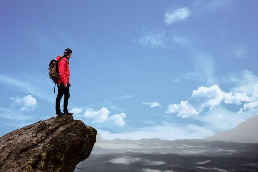 Man Standing on Cliff Photography Free Photo