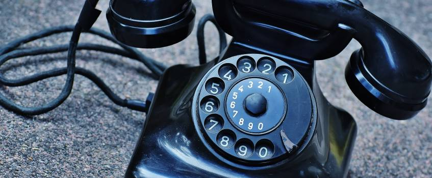 Black Rotary Telephone at Top of Gray Surface Free Photo