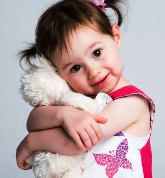 Girl Hugging Plush Toy #326737