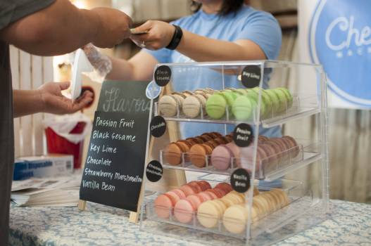 Black Sesame Key Lime Chocolate and Strawberry Macarons in a Glass Display Free Photo