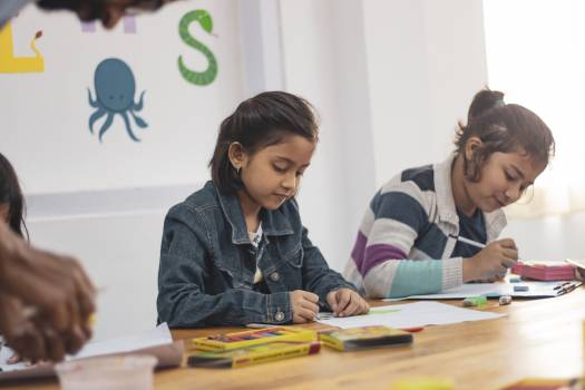 Two Girls Doing School Works Free Photo