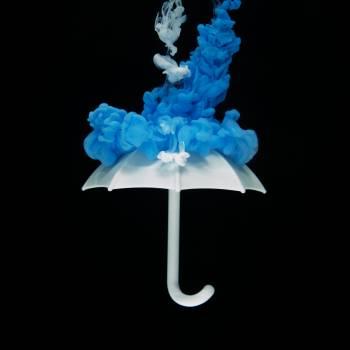Photo of White Umbrella With Blue Smoke Illustration Free Photo