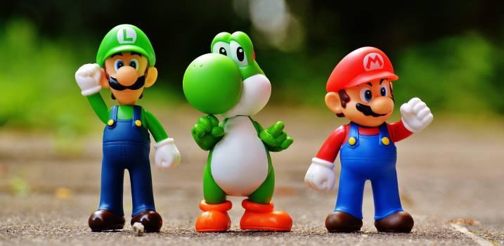 Focus Photo of Super Mario, Luigi, and Yoshi Figurines Free Photo