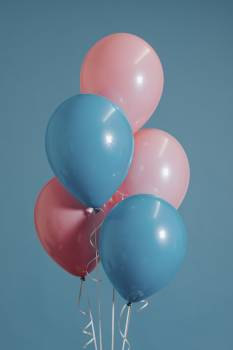 Closeup Photography of Two Teal and Three Pink Inflated Balloons Free Photo