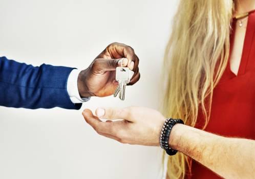 Person Handing Keys Free Photo