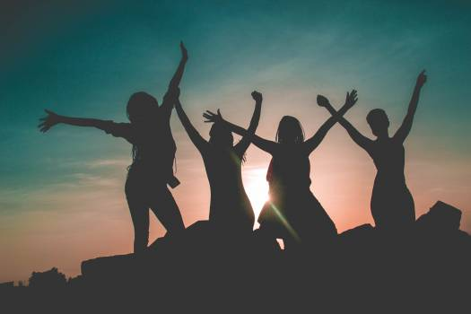 Silhouette of Four People Against Sun Background Free Photo