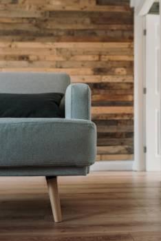 Gray Fabric Sofa Near White Wooden Wall #327775