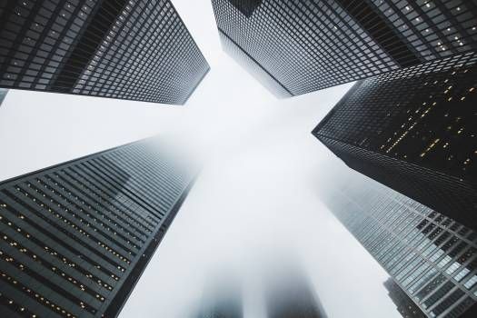 Low-angle Photography of Buildings Covered by Fog Free Photo
