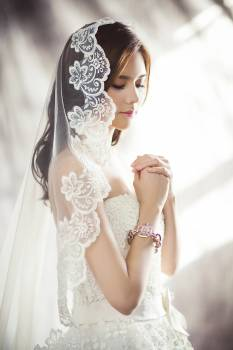 Woman in White Bridal Gown Meditating Free Photo