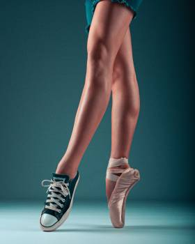 Photo of Person Wearing Sneaker and Ballet Shoe Free Photo