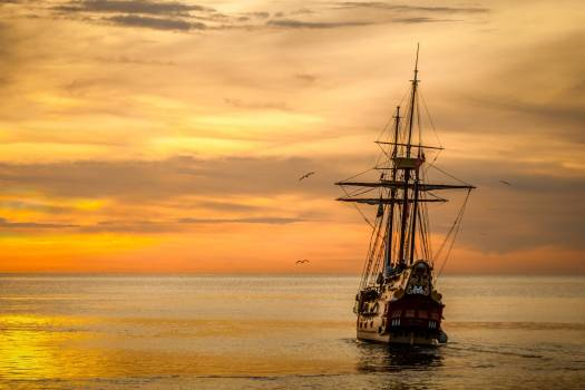 Brown Sailing Boat on the Sea during Sunset Free Photo