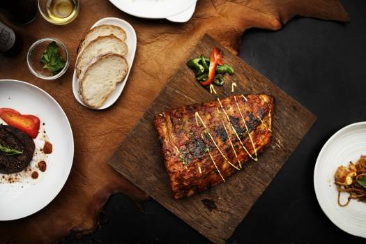 Flat Lay Photography of Grilled Meat on Brown Chopping Board Free Photo