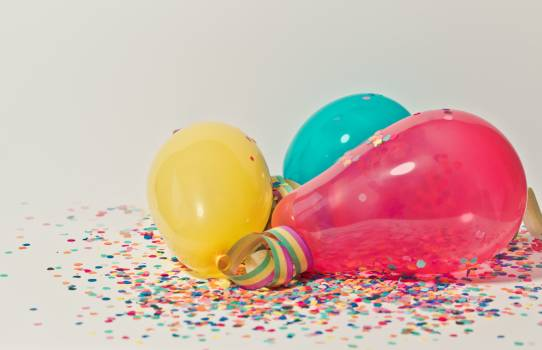 Yellow, Pink, and Blue Party Balloons Free Photo