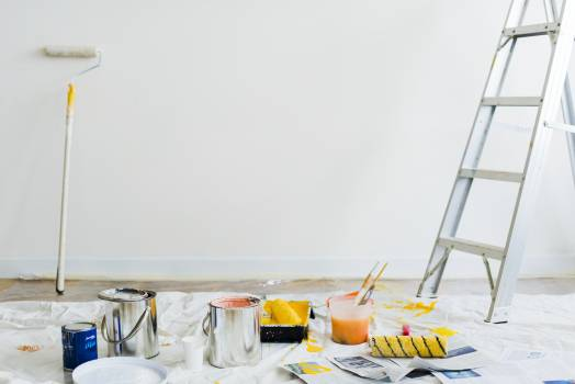 Painting Materials Scattered Inside Room Free Photo