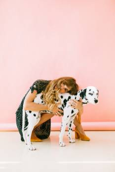 Woman Hugging Dalmatian Free Photo