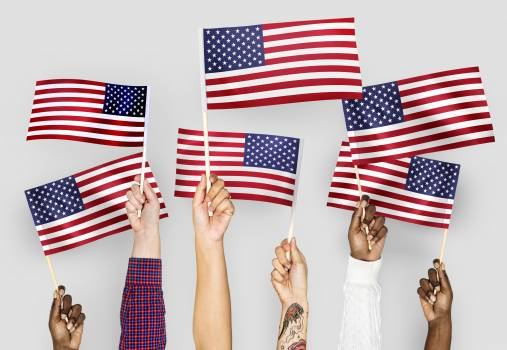 Close-up Photo of People Holding Usa Flaglets Free Photo